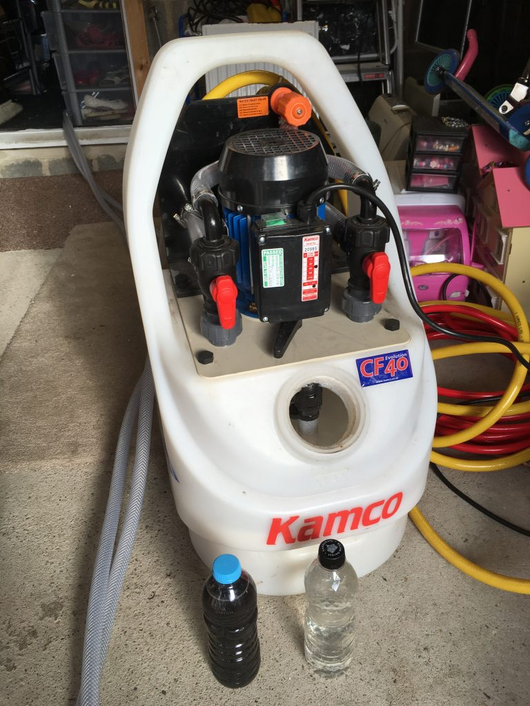 Kamco power flush machine in use carrying out power flushing in Leeds